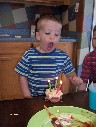 Jacob blows out candles